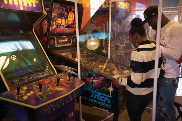 Happy Valley Arcade Bar features vintage pinball machines and arcade games. - DAVID MCINTYRE