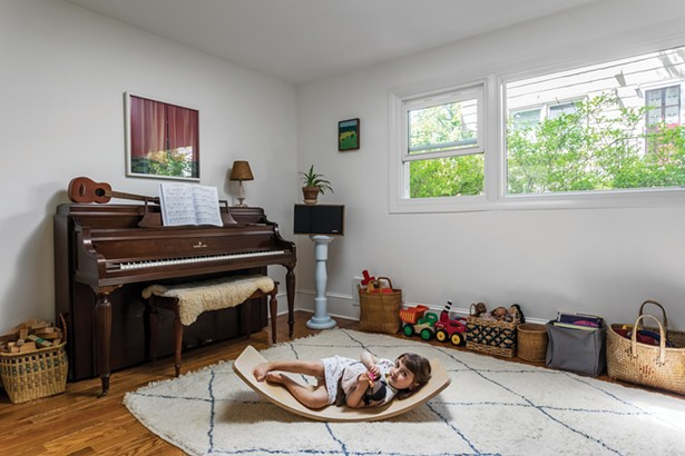 Winick and Bloomberg converted what was once a dental office reception area into a light-filled play nook. The area can be easily separated from the rest of the house with safety gates—allowing the children full ownership of the space. Above the piano, a close-up photo by Airyka Rockefeller of a shoe shelf in Vilnius, Lithuania. On the adjacent wall is a cyanotype by Nellie Appleby. - WINONA BARTON-BALLENTINE