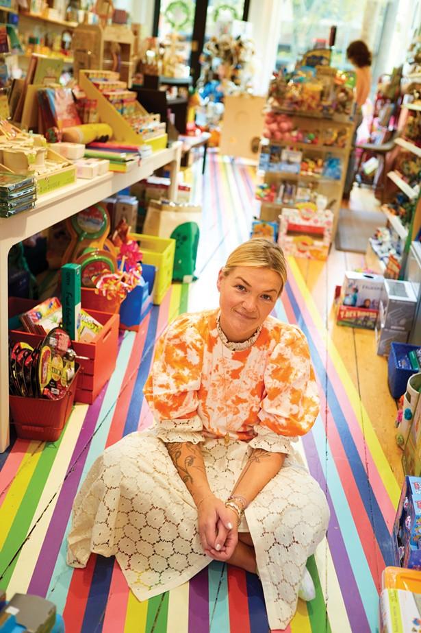 Elena Rose, owner of Land of Oz Toys, in her shop on East Market Street. - DAVID MCINTYRE