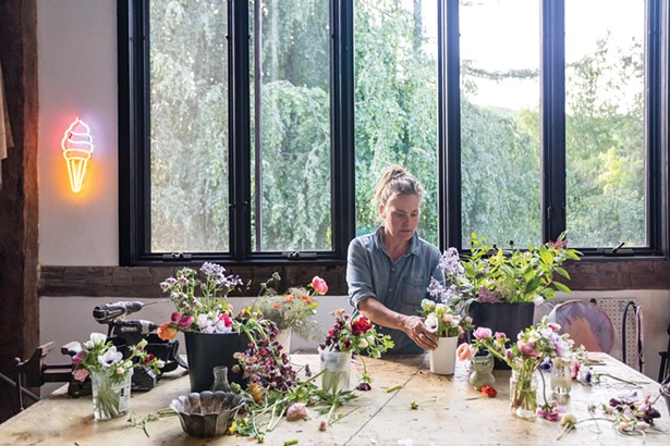 """Hall organizing her weekly late spring flower harvest. Crespell Farms, her flower CSA, delivers throughout the Hudson Valley from spring through the autumn—making weekly drops in Kingston, Hudson, and New York City. Its popularity is growing. """"I'm building a crew of some outstanding women who can take more of the reins next season,"""" she says. - WINONA BARTON-BALLENTINE"""