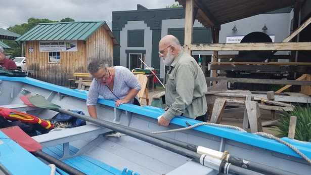 Jeanie Antonelle and Mike Sadowy inspect the John Magnus at the Hudson River Maritime Museum's Riverport Wooden Boat School.