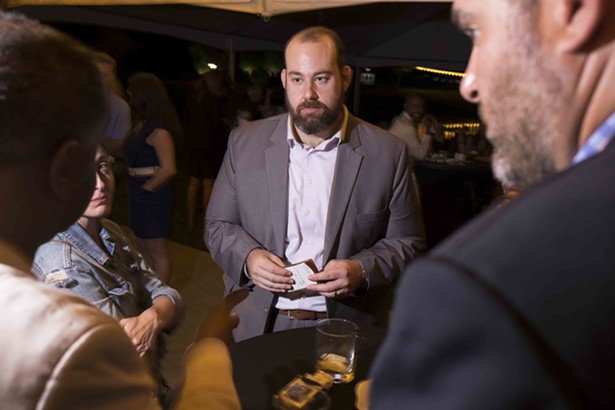 Norman Birenbaum, Director of Cannabis Programs at State of New York President of Cannabis Regulators Association, was in high demand at the event. - ROY GUMPEL