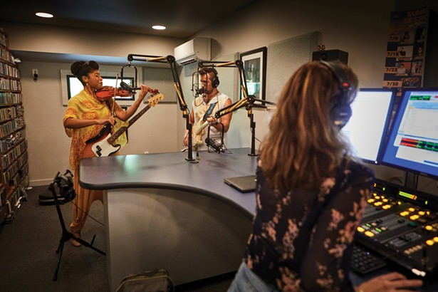 Inside Radio Woodstock's new home, a renovated church, DJ Aja broadcasts live with Aziza & the Cure, a wife-and-husband duo, Joelle and River Rouen. - DAVID MCINTYRE