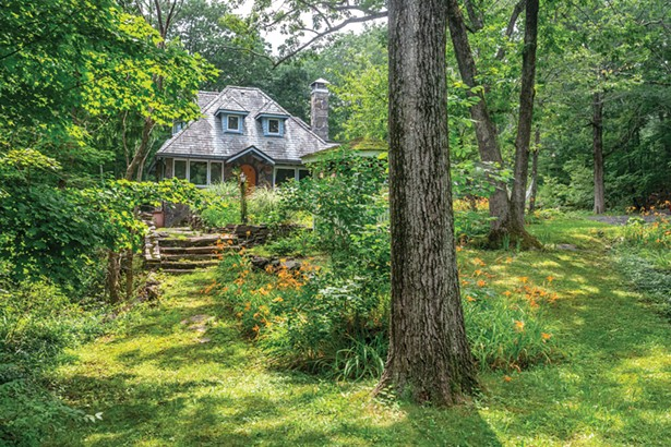 Linda Facci and Gene Gironda's home sits on three acres of gardens, winding bluestone paths, and stone terraces. The property sits in the heart of the former Maverick Art Colony, site of the early 20th-century music and art festivals held every summer. - WINONA BARTON BALLENTINE