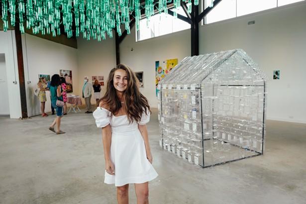"Gallery Director Tara Dalbow at The Barns Art Center's inaugural exhibition, ""Tasting Menu."" - PHOTO BY ROMMEL DEMANO, BFA"