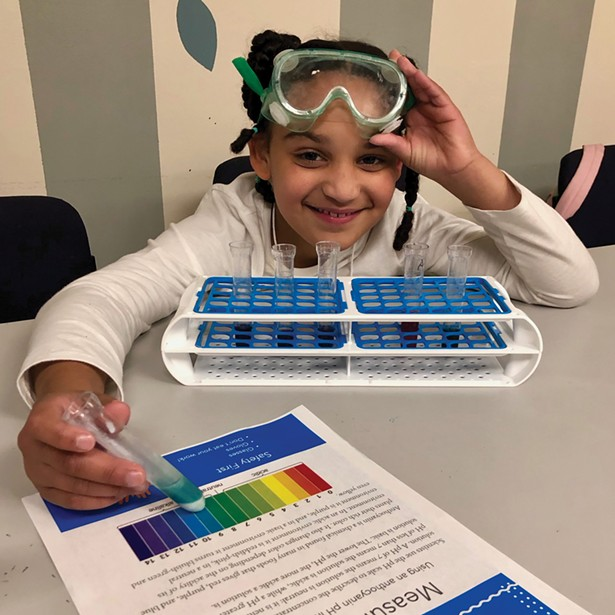 Exploring chemistry at the Girls Science Club afterschool program.
