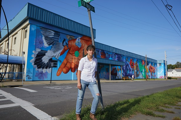 O+ Art Director Lindsey Wolkowicz in front of the mural she recently completed with fellow artist Gaia. - DAVID MCINTYRE