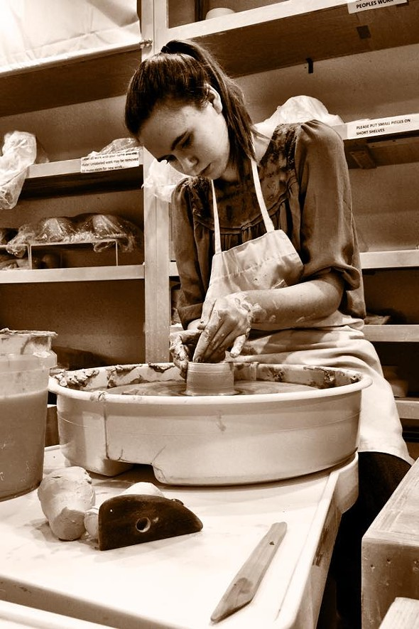 A student at the wheel at Hudson Valley Pottery. - JUDI ESMOND