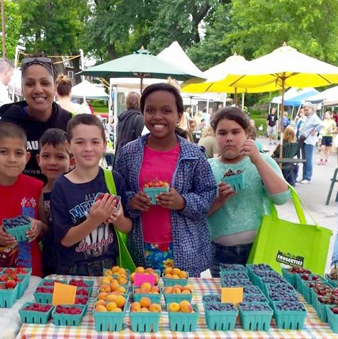 AnnChris Warren and kids from the Leadership Program at the Boys & Girls Club of Saugerties at the Saugerties Farmer's Market - COURTESY OF ANNCHRIS WARREN