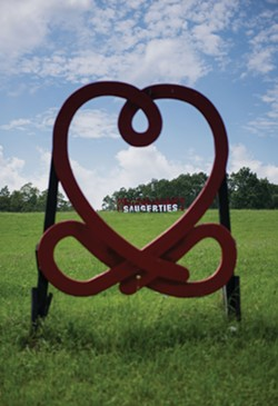 Love Knot sculpture by Ze'ev Willy Neumann and sign leading into Saugerties - CHRISTINE ASHBURN