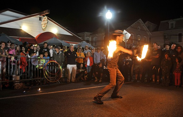 Crowds at the Windham World Cup Block Party enjoy the - fire stunt performer, Lyca on Fire - DAVE KRAUS, KRAUSGRAFIX.COM