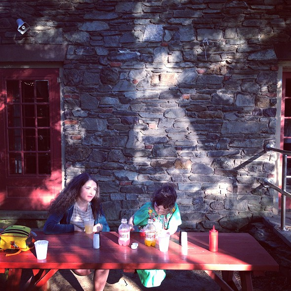 Outdoor seating at The Matchbox Cafe - HILLARY HARVEY