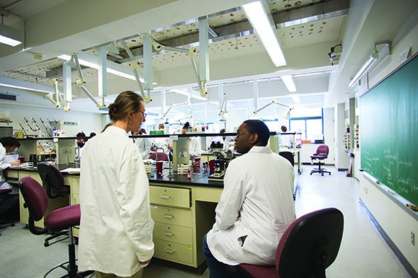 Professor Maureen Morrow works with a student in the Molecular Biology Lab.
