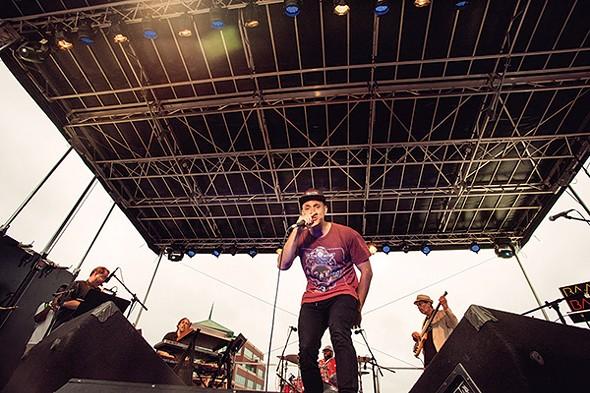 Hip-hop artist Decora performing at the Newburgh Illuminated Festival - RUEDI HOFMANN