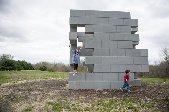 Kids play on Iran do Espírito Santo's cast concrete Playground, an interactive monumental sculpture created in 2013 - HILLARY HARVEY