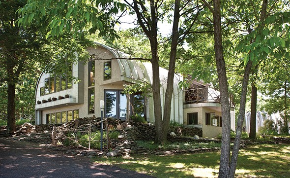 """The west facing front of Linda and Andy Weintraub's house. The couple have created a property where the materials utilized—steel and stone, wood and water, and even animal life—all naturally flowing together in """"beautiful progressions."""" - DEBRA DEGRAFFENREID"""