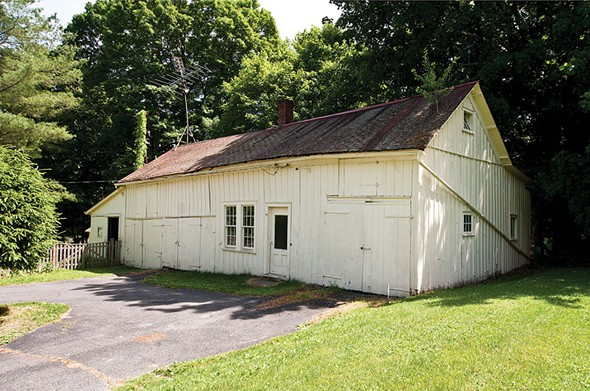"""""""The Dog House"""": The couple have converted the home's original barn into a rustic office/den with an adjoining workshop. (Its also where they feed Dean.) - DEBORAH DEGRAFFENREID"""