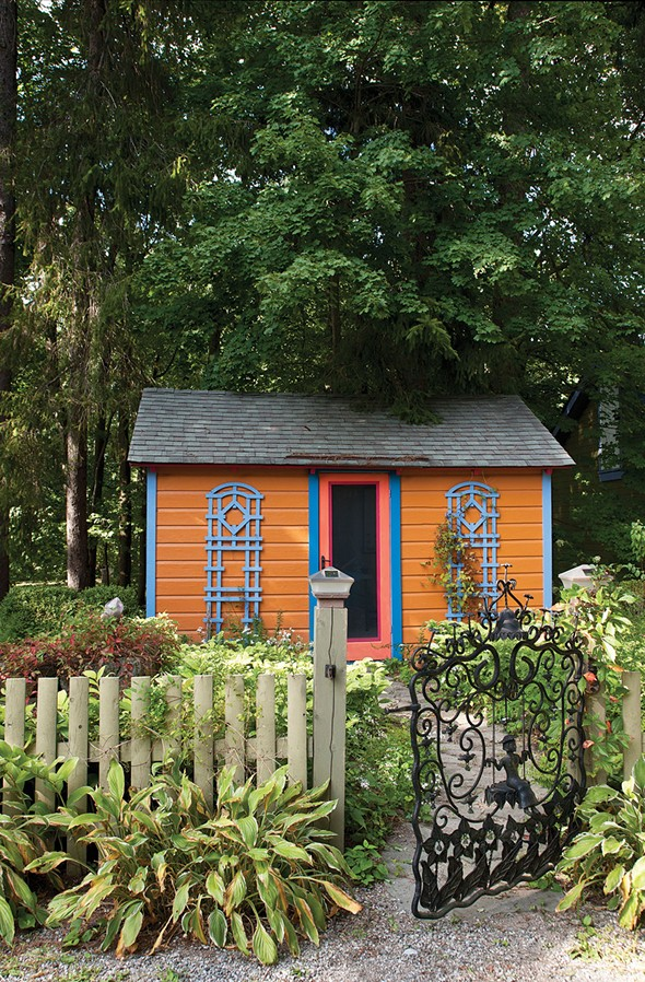 O'Garden's writing cottage nestled among trees on the property. - DEBORAH DEGRAFFENREID