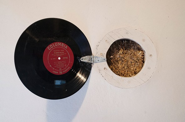 In a wall of Dean Jones's No Parking Studio in Rosendale, a porthole fashioned from an old LP opens to display the core of its straw-bale construction - FIONN REILLY
