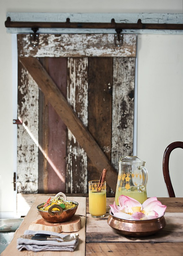 "The dining room where Narine serves her ""spice suppers."" She transplanted doors from her Dutch barn to give the room a rustic flair. - DEBORAH DEGRAFFENREID"