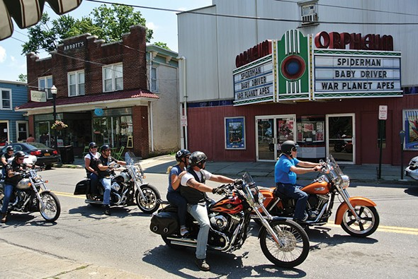Bikers in formation outside the Orpheum movie theater in Saugerties. - JOHN GARAY