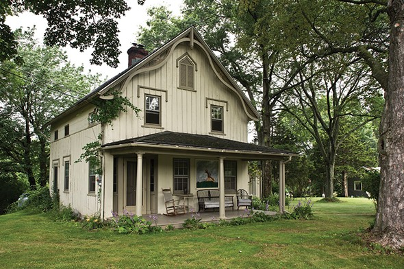"""Valerie Shaff's Carpenter Gothic cottage was designed by 19th-century landscape architect A. J. Downing. Downing was inspired by both the romantic movement and the egalitarian ideals of early American life. """"Tasteful simplicity, not fanciful complexity, is the true character of cottages,"""" he wrote in The Architecture of Country Houses. """"Nature here, as always, must constantly be respected."""" - DEBORAH DEGRAFFENREID"""