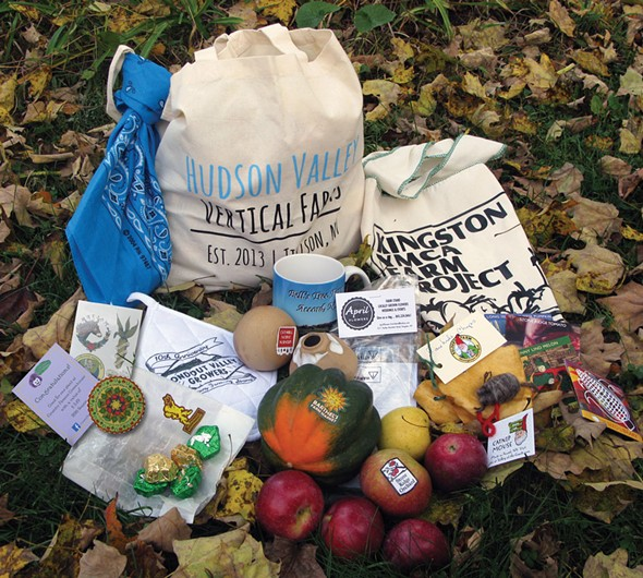 A Hudson Valley Vertical Farms market bag filled with goodies—the reward for collecting all the stickers on the Stick to Local Farms map.
