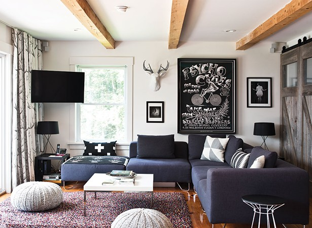 """The couple's living room is decorated with a blend of pieces from each of their lives. """"I'm trying to create a haven for people,"""" Cummings explains about her work.Successful interior design is a combination of understanding the integrity of an individual space, as well as the people who are living in it and how they want to live."""" - DEBORAH DEGRAFFENREID"""