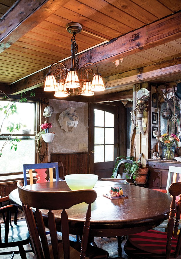 """The home's original one-room cabin is now the family dining room. When they first bought the house, the floors were covered with thick orange and brown shag carpeting. """"Underneath that was linoleum from the `70s, and under that was linoleum from the `30s,"""" Shaftan Perrin remembers. The eventually uncovered wide-plank wood floors. - DEBORAH DEGRAFFENREID"""