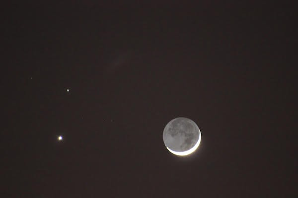 "The February 2015 conjunction of Venus and Mars, with a crescent Moon mimicking this week's Full Moon via what's called ""Earthshine."" - PHOTO BY AMANDA PAINTER."