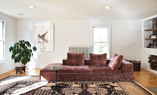 Previous owners had extended the home's original living room by eight feet. Quatrefoil helped Von Stoddard redesign the space to include built-in bookshelves, a cut out for wood storage, and a wood stove. - DEBORAH DEGRAFFENREID