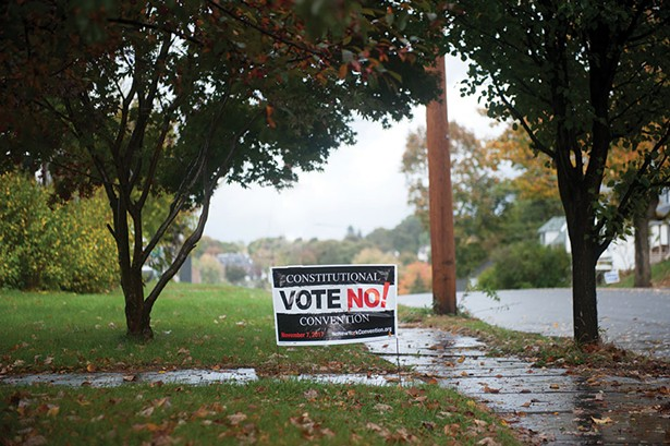 A no-vote yard sign on a lawn in Kingston.