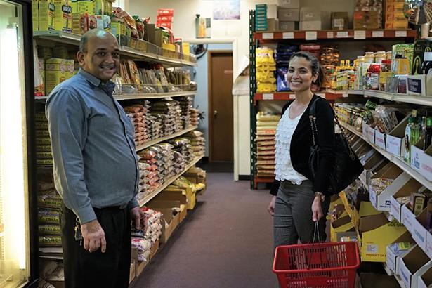 Mahesh Patel, owner, and Radhika Shah at Saraswati Grocery in Wappingers Falls. - JOHN GARAY
