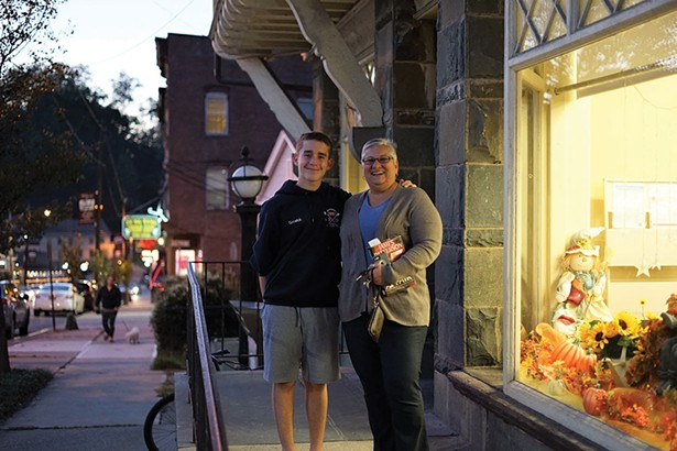 Daniel and Jo Ann Goswick in front of Grinnell Library in Wappingers Falls. - JOHN GARAY
