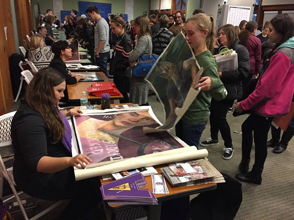 Art Institute of Mill Street Loft student Isabel Long shows her portfolio to a rep from Alfred University at the 2016 Hudson Valley Regional Portfolio Day