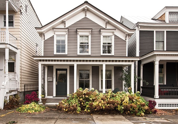 Smith restored the facade of the Greek Revival cottage with an eye for historic detail. What couldn't be salvaged from the original design was carefully recreated. - DEBORAH DEGRAFFENREID