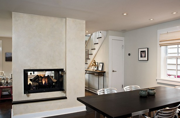 After removing the interior walls, Smith added a steel beam across the ceiling to support the chimney shaft. The metal and wood entrance table in the foyer is the creation of Smith's wife, furniture designer Jules Anderson. Anderson specializes in utilizing natural materials in a contemporary fashion, and often recycles wood from local antique shops. Modernizingwhile still remaining true to a home's (or a piece's) historical roots is central to both their practices. - DEBORAH DEGRAFFENREID