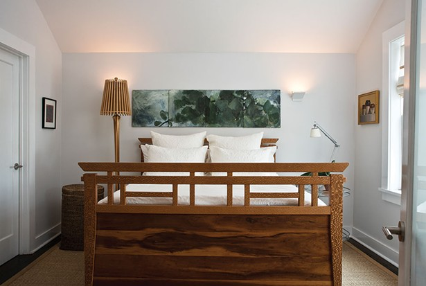 """While Smith didn't add actual space to the home's second floor, she was able to add spaciousness. Smith is inspired, in part, by Japanese architecture where a simple, contextual aesthetic predominates design. """"The negative space is almost more important than what you fill a room with,"""" she explains. The bed was designed by her brother, Dave Smith, of Ingrain Furniture in Seattle. - DEBORAH DEGRAFFENREID"""