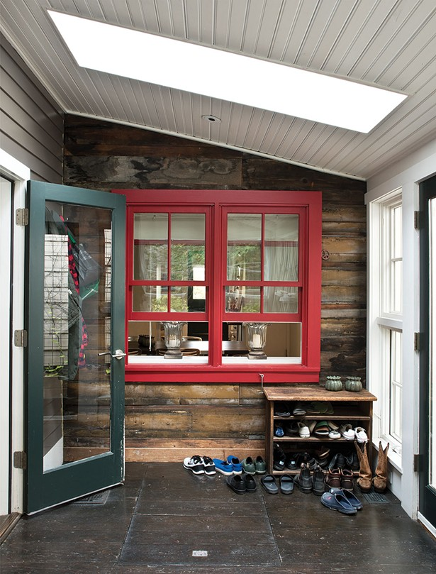 Smith added an insulated glass door between the kitchen and the three-season porch as well as a skylight, allowing the home's ambiance of interconnected indoor-outdoor spaces to remain during colder weather. - DEBORAH DEGRAFFENREID