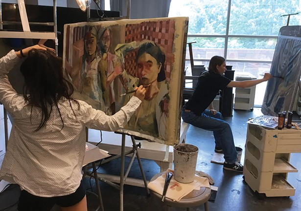 Yan Lam Ko painting at the 2017 Summer Art Institute.