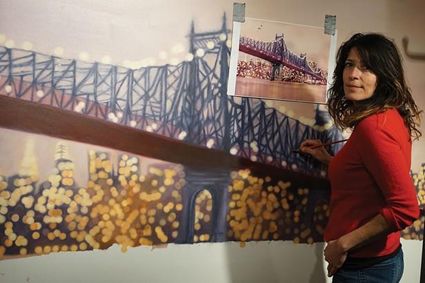 Sonne Hernandez with her artwork at PLACE gallery in Millerton. - JOHN GARAY