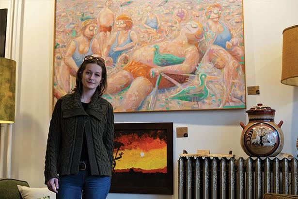 Monik M. Geisel at Stuff in Rosendale, with Zombie Sun Bathers, a painting by Headley Harper - JOHN GARAY