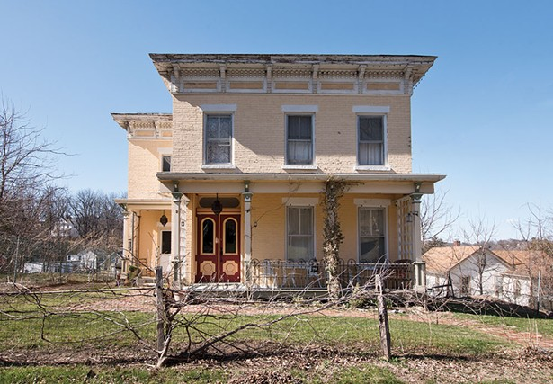 Khorramian's home dates from 1840 and features many classic Italianate architectural details. A flat roof with a wide overhang is supported with curved cornices and an ornate border. The yellow brick facade and teal trim is also original to the structure. - DEBORAH DEGRAFFENREID