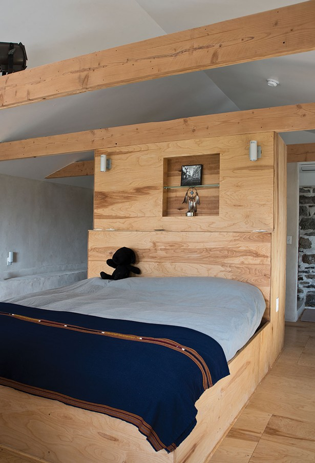 """Zeller's master suite has an open vintage tub and views to the Catskills. """"The house brings me back to Austria,"""" say Zeller. """"It reminds me of an Austrian mountain house.It's almost like a fortress, the house has stood 300 years, why should it crash down now? It's very different than a wood house."""" - DEBORAH DEGRAFFENREID"""