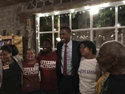 Delgado takes photos with ecstatic supporters. - ANDREW SOLENDER