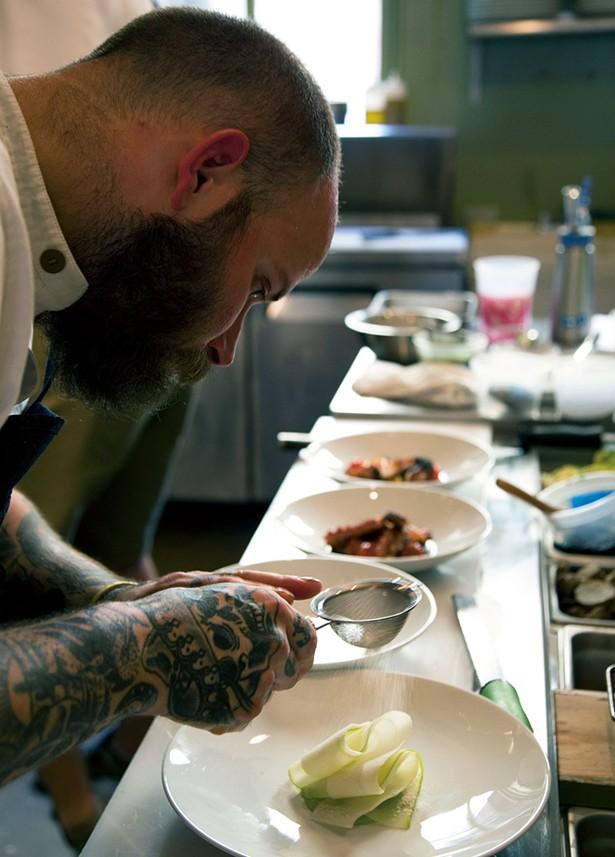 Chef Chris Turgeon plating an apple salad with German-engineering-level precision. - PETER BARRETT