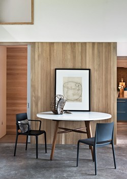 Throughout the house, oak finishes installed by local craftsmen Lee Sahler and Brandon Pra offer a warm counterpoint to the concrete slab floors and a marble and walnut table created by Hudson Workshop. - DEBORAH DEGRAFFENREID