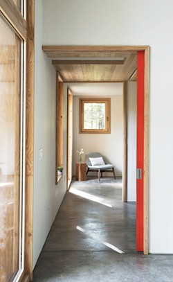 Reynolds installed pocket doors throughout the house. Maximizing the flow of light, heat, and air, they also allow the rooms to easily change from openness to privacy. An east-facing window at the main bedroom offers an additional view of the surrounding woods. - DEBORAH DEGRAFFENREID