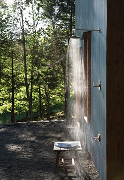 Reynolds installed an outdoor shower in a secluded spot behind the house. Corrugated steel siding is a durable, maintenance-free exterior finish, and blends well with the surrounding landscape. - DEBORAH DEGRAFFENREID