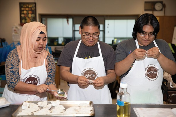 Students from Hudson High School make dumplings using fresh ingredients.